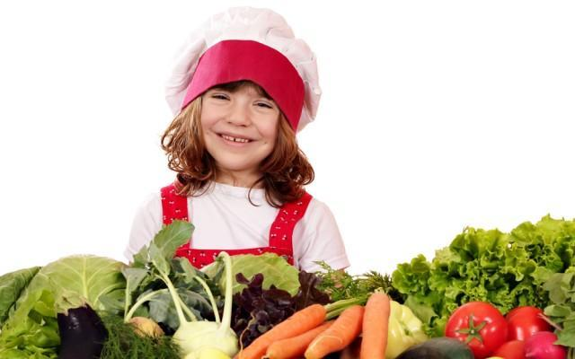girl with veggies in a chef's hat